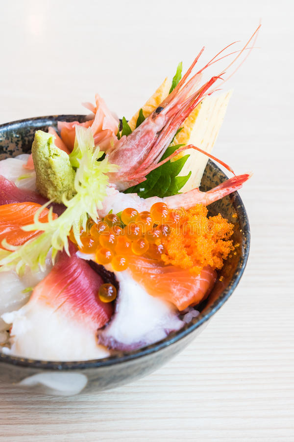 Japanese rice bowl with sashimi seafood on top. Selective focus point royalty free stock photos