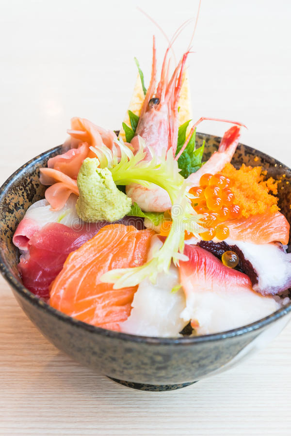 Japanese rice bowl with sashimi seafood on top. Selective focus point stock photography