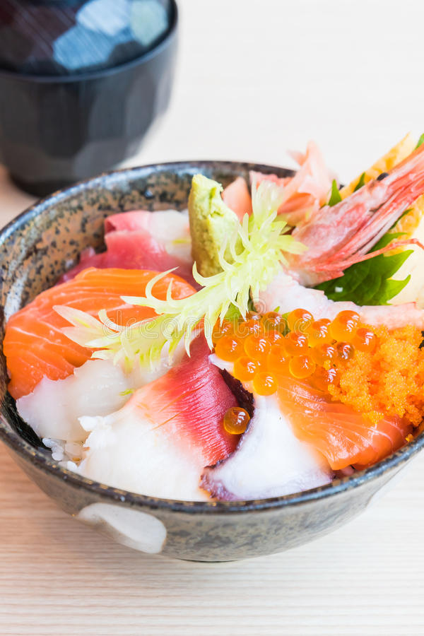 Japanese rice bowl with sashimi seafood on top. Selective focus point stock images