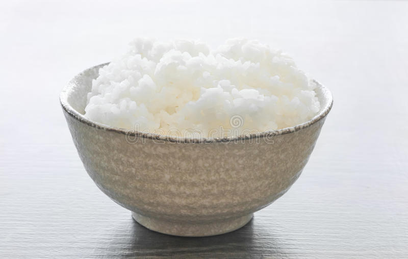 Japanese rice in bowl on wood royalty free stock photo