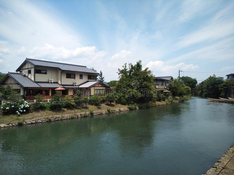 Japanese river house architecture blue cloud sky stock images