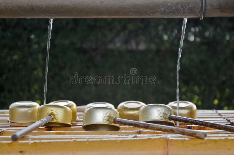 Japanese sacred ladles and holy water in local shrine in Kyoto royalty free stock photos
