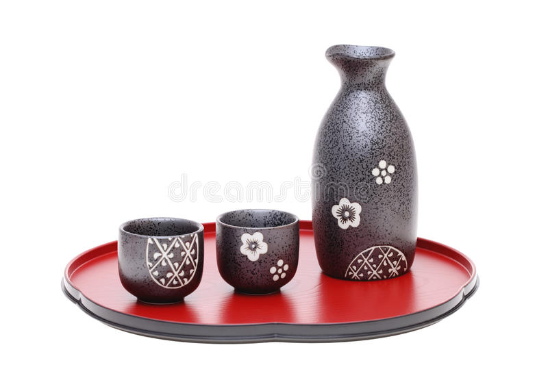 Japanese sake bottle and cup. On tray, isolated on white background royalty free stock photos