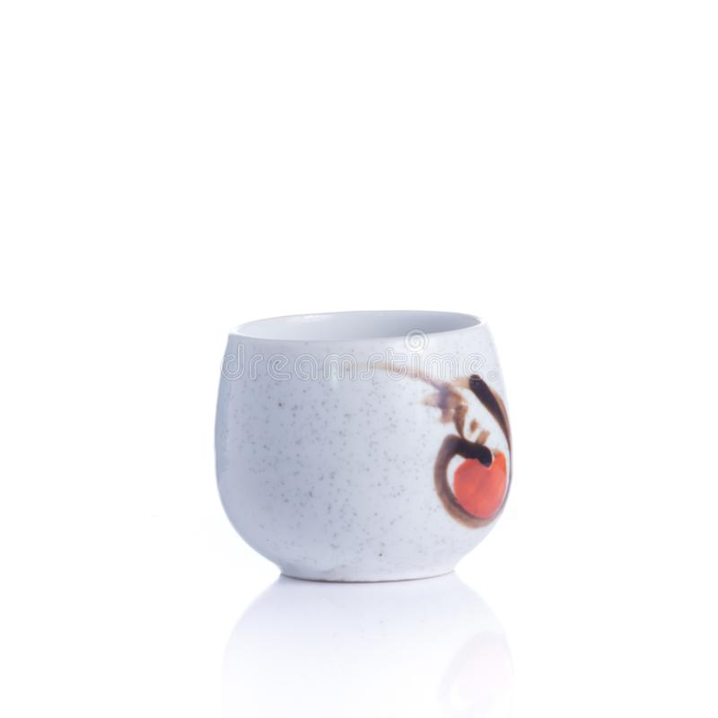 Japanese sake cup and bottle isolated. Japanese sake cup and bottle on white background stock photo