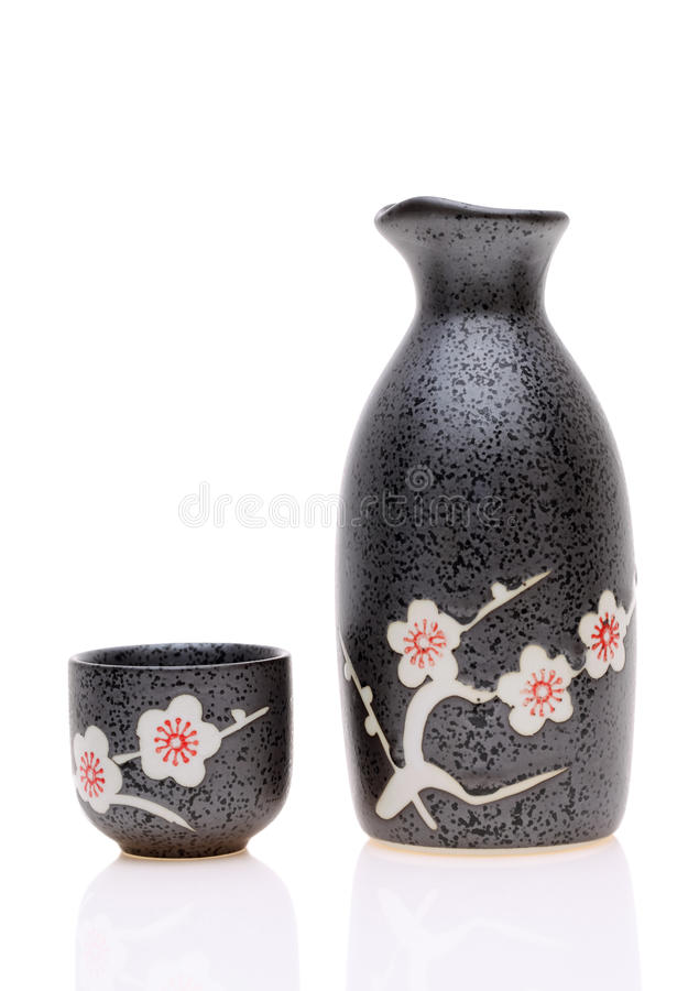 Japanese sake cup and bottle. Traditional Japanese sake cup and bottle on white background stock image