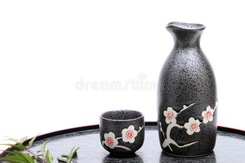 Japanese sake cup and bottle. Traditional Japanese sake cup and bottle on white background stock photography