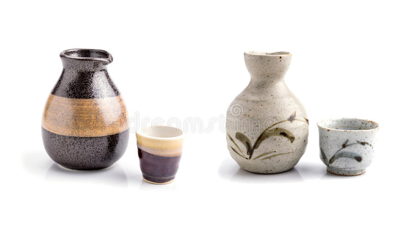 Japanese sake cup and bottle. On white background royalty free stock image