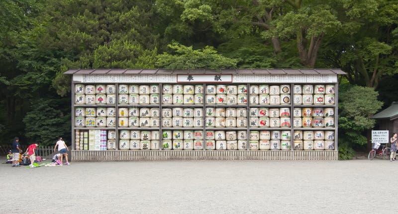 Japanese sake rice wine barrels. KAMAKURA, JAPAN-8 SEPTEMBER: Japanese sake rice wine barrels with decorative writing in Tsurugaoka Hachiman Shrine Temple on stock photography