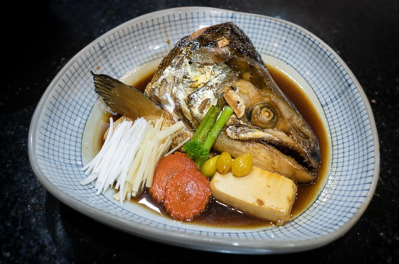 Japanese salmon head  steamed with vegetables. Salmon head  steamed with sweet sauce and vegetable in Japanese style stock images
