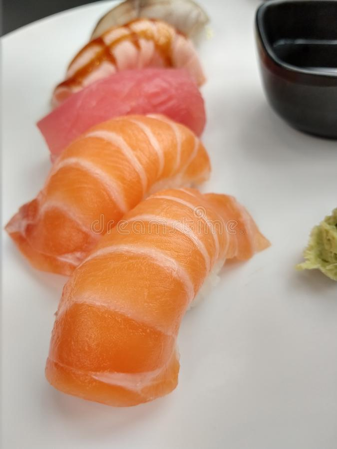 Japanese salmon sushi in plate. Japanese salmon sushi plate food royalty free stock photography