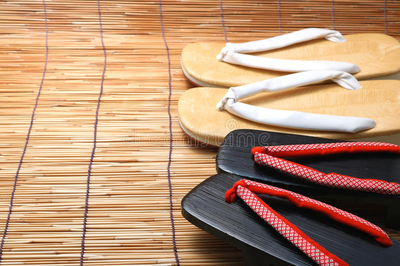 Japanese sandals for men and women on bamboo blinds. Concept of Japanese summer stock photography