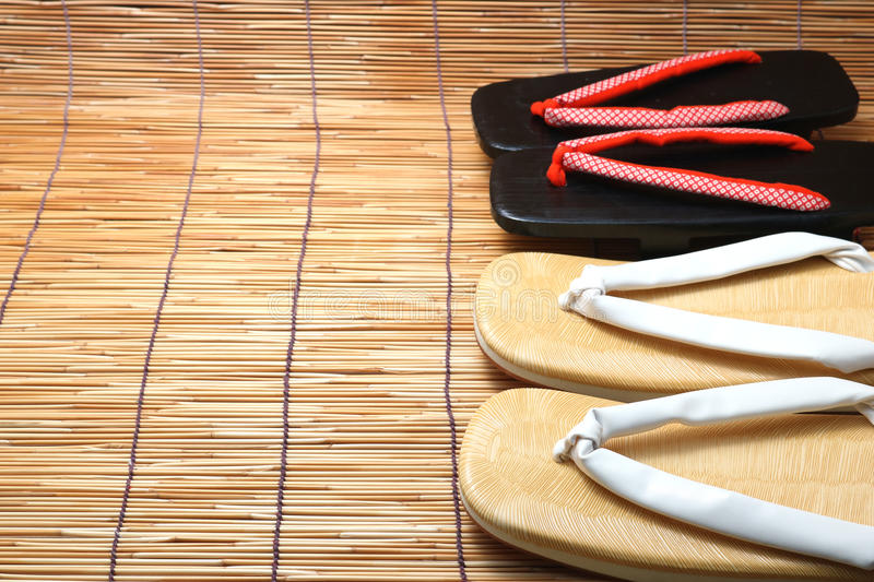 Japanese sandals for men and women on bamboo blinds. Concept of Japanese summer stock image