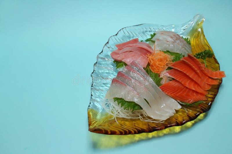 Japanese sashimi assortment in the blue. Background royalty free stock image