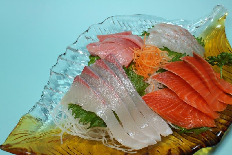 Japanese sashimi assortment close up in the blue. Background stock photo
