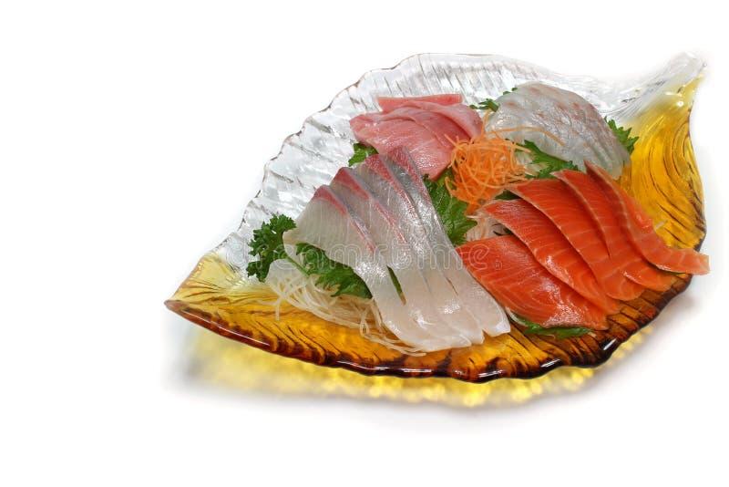 Japanese sashimi assortment in the white. Background stock images