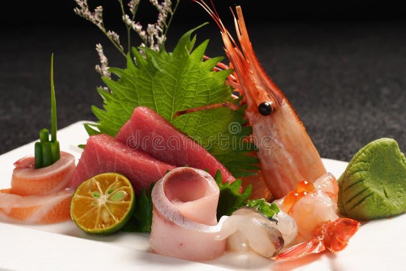 Japanese sashimi platter. Shrimp salmon and snapper sashimi royalty free stock image