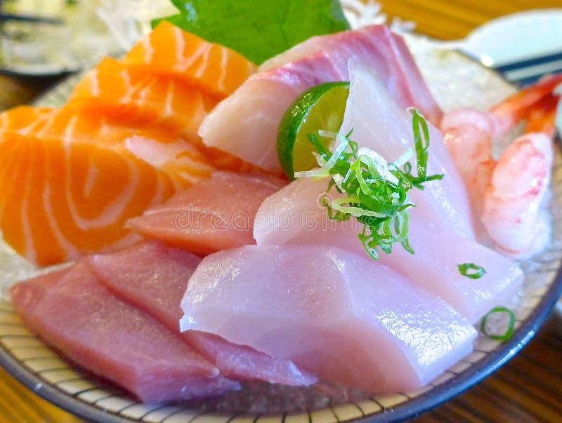 Japanese Sashimi with raw fish. At restaurant royalty free stock photos