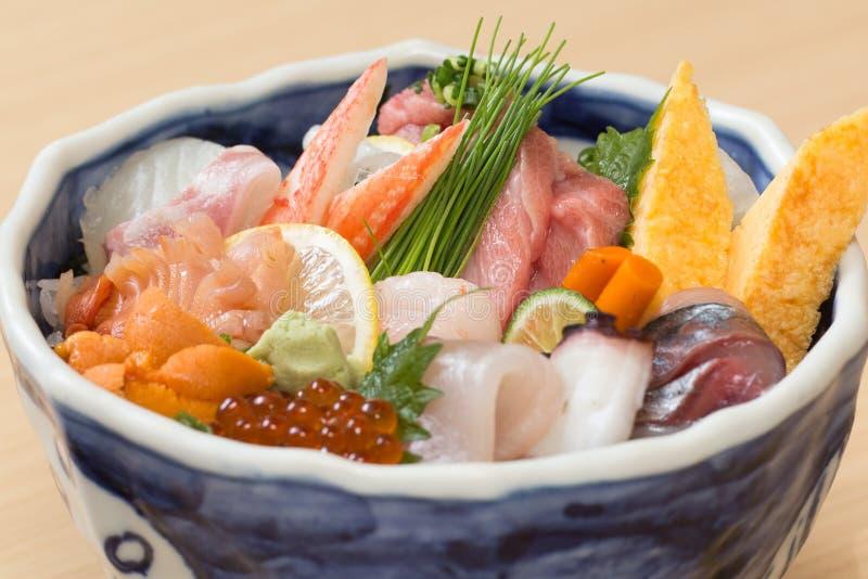 Japanese sashimi raw fish rice bowl. Traditional Japanese rice bowl with various kinds of fresh raw fish sashimi royalty free stock photography