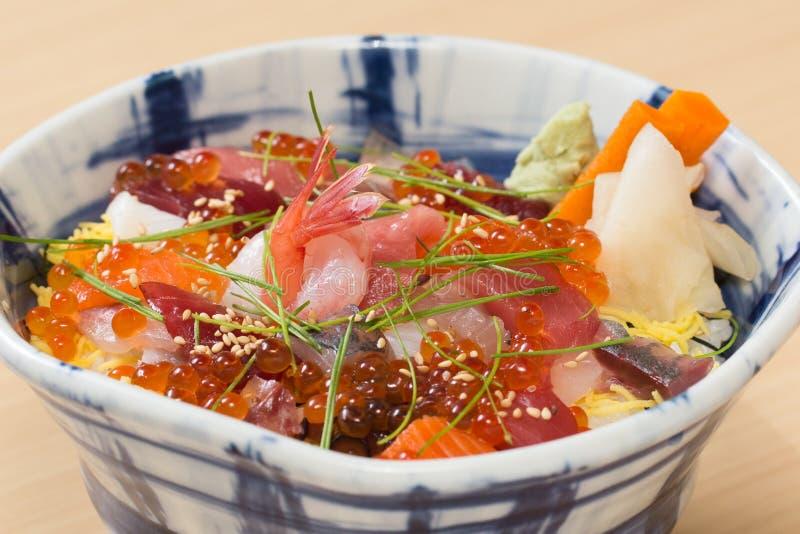 Japanese sashimi raw fish rice bowl. Traditional Japanese rice bowl with various kinds of fresh raw fish sashimi stock photo