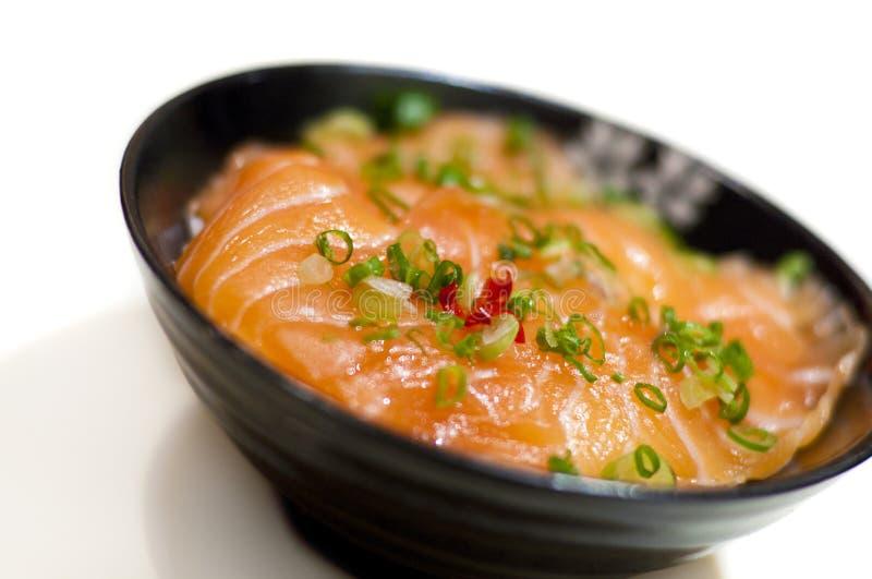 Japanese sashimi rice. Japanese style raw salmon fish (sashimi) rice royalty free stock photos