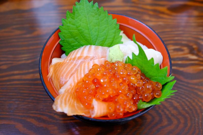 Japanese sashimi with sliced fish and shrimp eggs in a cup Original of Japan. Japanese sashimi with sliced fish and shrimp eggs stock photo