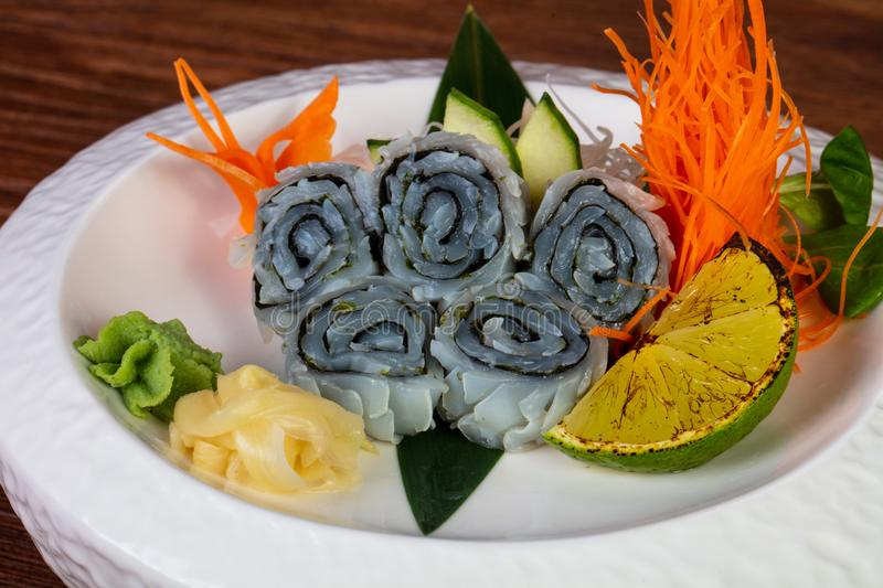 Japanese sashimi squid. Served lime and mint royalty free stock image