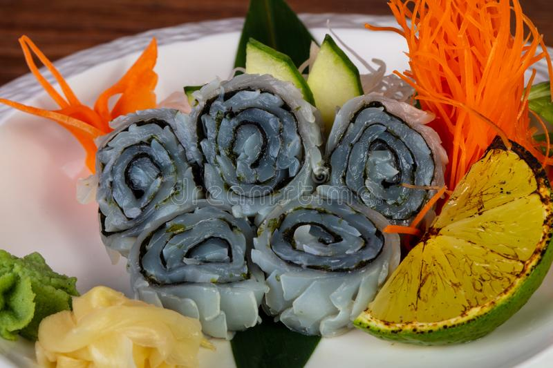 Japanese sashimi squid. Served lime and mint stock image