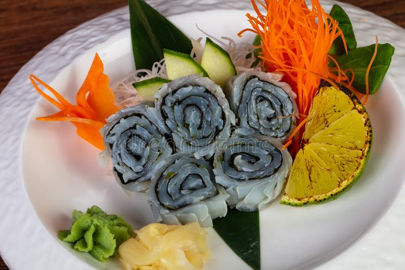 Japanese sashimi squid. Served lime and mint royalty free stock photo