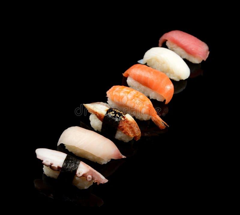 Japanese sashimi sushi set on black background. Close up of Japanese sashimi sushi set on black background royalty free stock photography