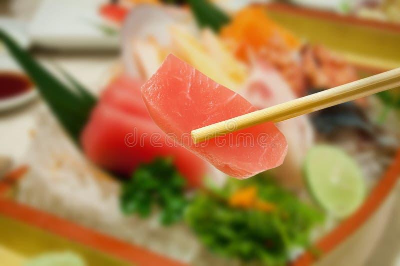 Japanese sashimi tuna with sashimi set. Background royalty free stock images