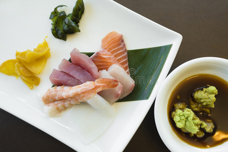 Japanese sashimi with wasabi and pickles. Toop down view of Japanese sashimi with wasabi and pickles royalty free stock photo