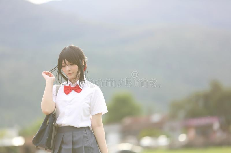 Japanese school in countryside with grass mountain and tree royalty free stock photography