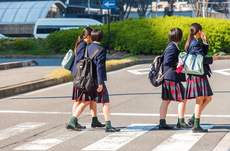 Japanese schoolgirl on a city street, Kyoto, Japan. Copy space for text. stock image