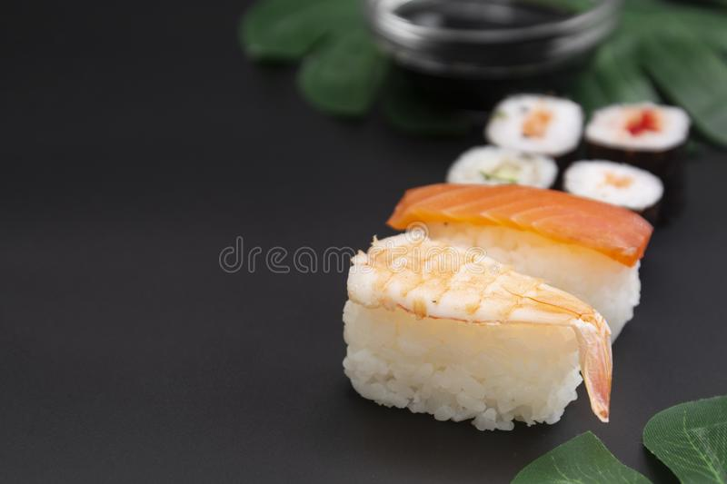 Japanese seafood sushi set on black background isolated, copy space royalty free stock photos