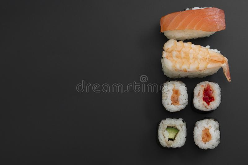 Japanese seafood sushi set on black background isolated, copy space stock images
