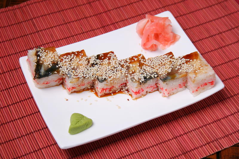 Japanese seafood sushi. Japanese sushi seafood. Square slices of eel, rice, eggs and sesame stock images