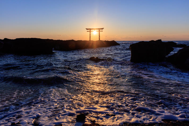 Japanese shrine gate in sunrise royalty free stock images