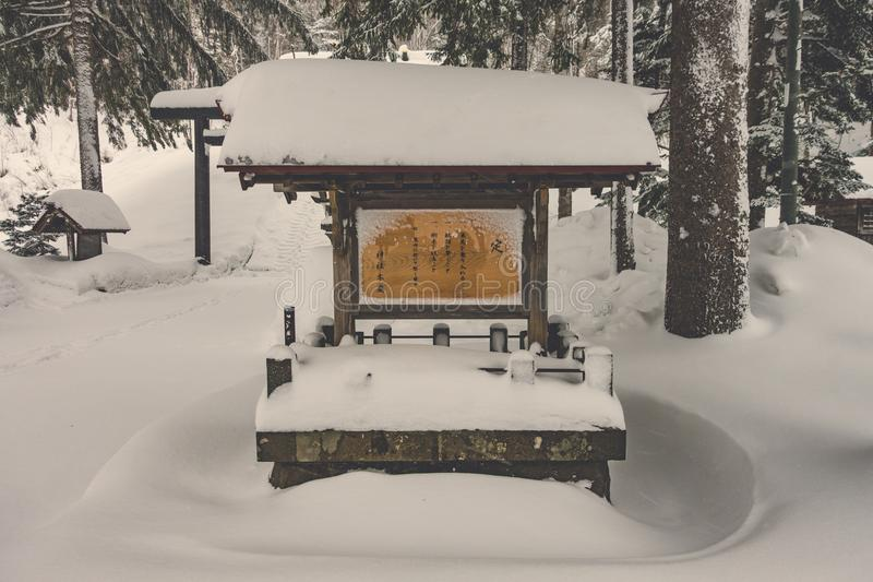 Japanese Shrine with snow in winter stock photography