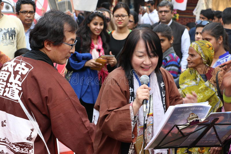 A Japanese singer. Singing, a musician playing guitar & people are enjoying in Surajkund public craft fair in Surajkund, Faridabad, India royalty free stock images