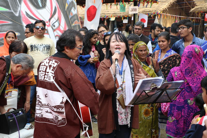 Japanese singer. Singing, a musician playing guitar & people are enjoying in Surajkund public craft fair in Surajkund, Faridabad, 2016 India stock photo