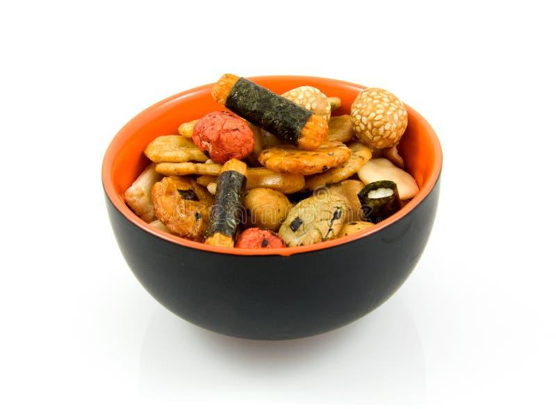 Japanese snacks in bowl royalty free stock image