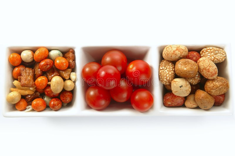 japanese snacks and tomatoes stock photo