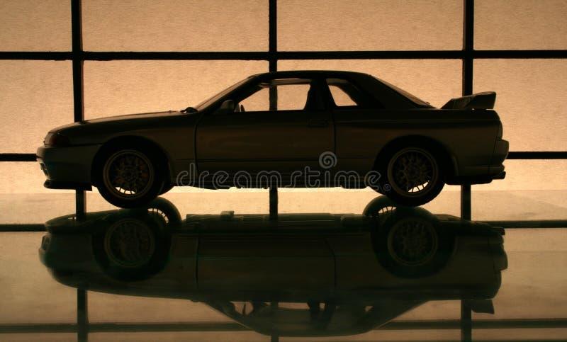 Japanese sports car. A fast Japanese sports car, silhouette stock photos