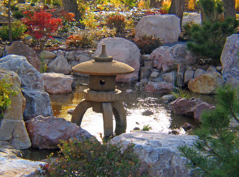 Japanese statue Gardens in early fall. Japanese Gardens in early fall at the botanical gardens in Albuquerque New Mexico. Waterfalls, oriental statues, Koi ponds stock images