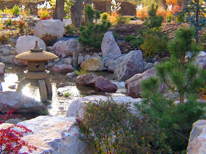 Japanese statue Gardens in early fall. Japanese Gardens in early fall at the botanical gardens in Albuquerque New Mexico. Waterfalls, oriental statues, Koi ponds stock photo