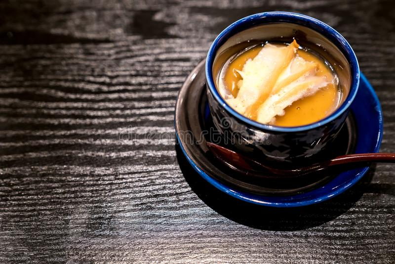 Albalone Steamed egg. Japanese Steamed egg with butter grilled abalone royalty free stock image