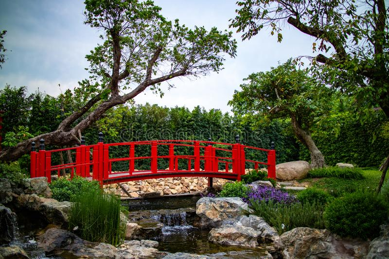 The japanese style of red wooden bridge in the garden royalty free stock photos