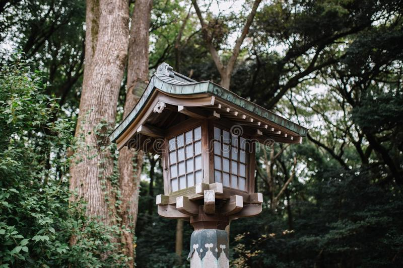 Japanese style wooden lantern With trees on background. stock photos