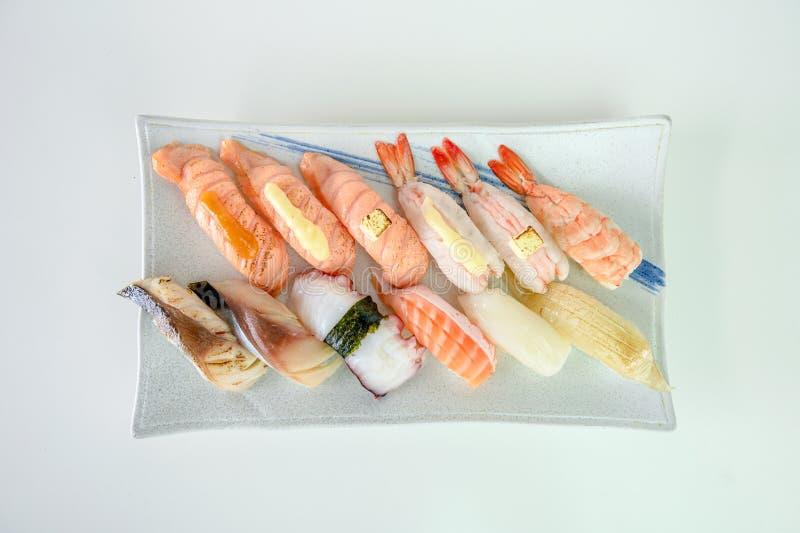 Japanese sushi nigiri of Salmon, Shrimp, Saba, Tako, Squid, Engawa on ceramic plate stock photography