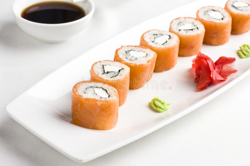 Japanese sushi rolls with salmon, serving with soy sauce, wasabi royalty free stock image